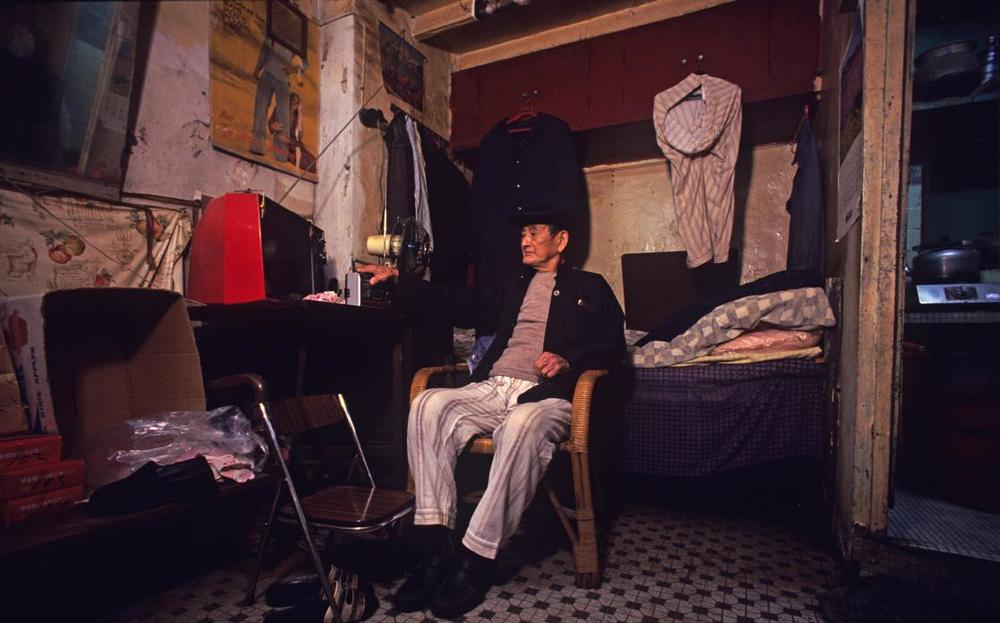 Walled city resident in his 7x12 ft home, 1989  © Greg Girard