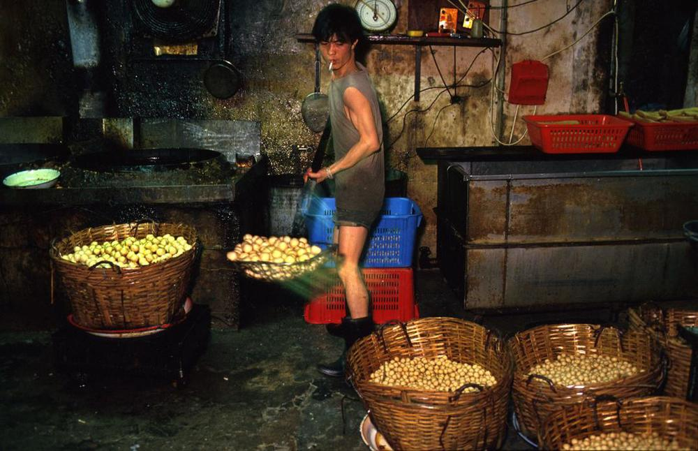 Worker in Fishball Factory, 1987  © Greg Girard