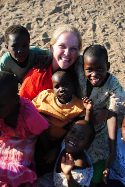 Holly with the children at Lake Malawi.