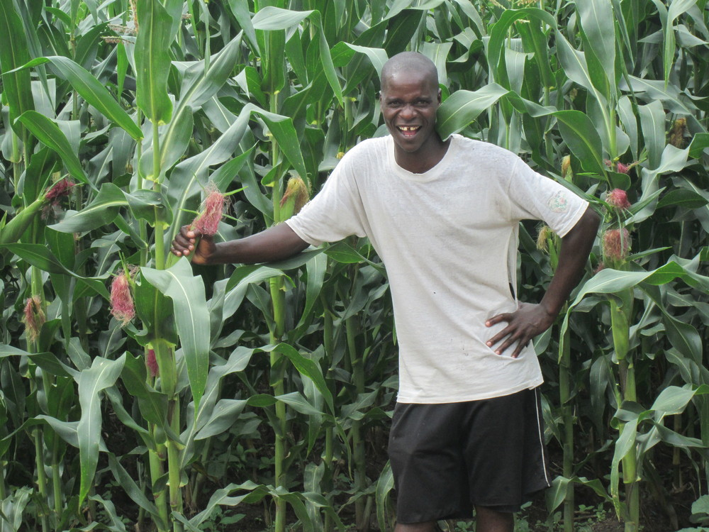 Pastor Byson shows off our beautiful corn crop on the Chipoka Farm.