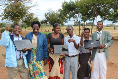 Mrs. Bokho (second from the left) and the other administrators that run the Grace Center in our computer class Summer 2014. This was the first time any of them used a computer. They were trained in mainly typing skills, but they also learned Microsoft Office too!