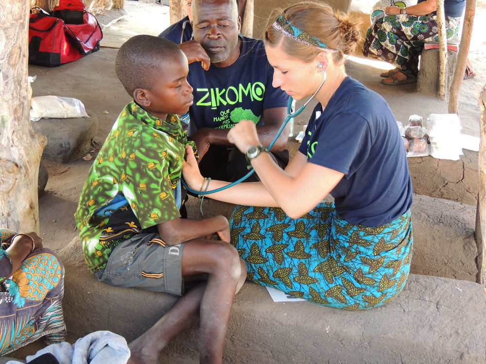 Karly working in the clinic at our Chipoka Project.