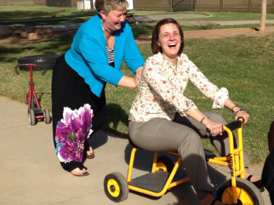 Riding the bike at the playground at Texas Tech as we dream about our Playground for the Grace Center!