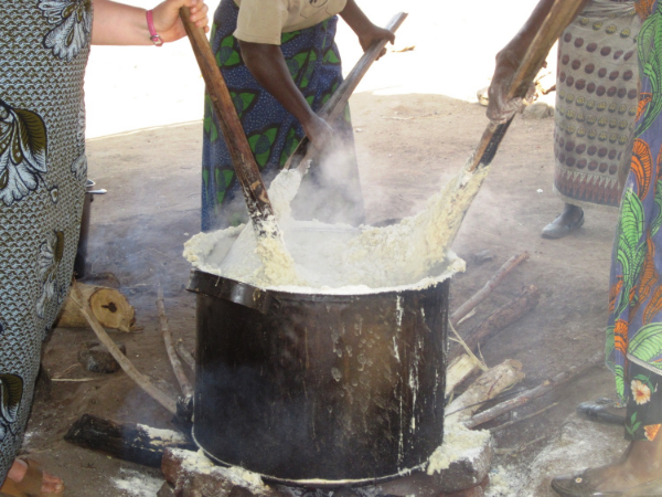 Ground corn is then cooked into a heavy paste called Nsima. Most Malawians name Nsima as their favorite food.