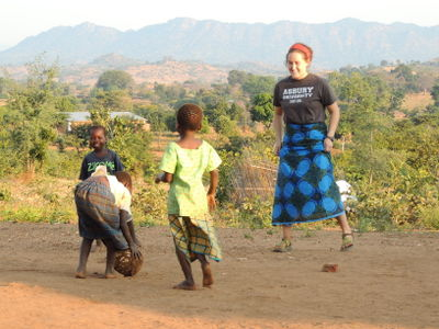 Rachel, one of our team members from Asbury University with some of our children in Malawi.