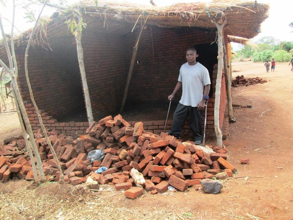 James in front of his rented home which was destroyed in the terrible storm last week.