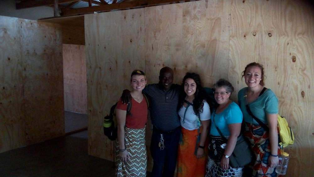 Our medical team and Pastor Phiri in front of the new walls in the clinic! We are building these as dividers for our large room to make it into an exam room, treatment room, and waiting room.