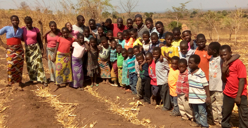 Pastor Phiri and the boys and girls of TImothy's and Patricia's Homes on the new land we are hoping to purchase soon!