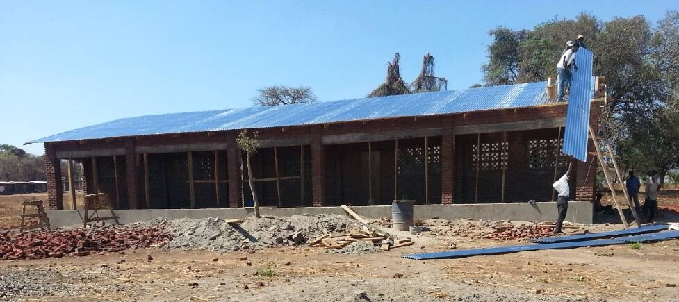 Putting the roof on our newest classroom block. This will house 5th and 6th grade. Photo Credit: Pastor Phiri 10/17