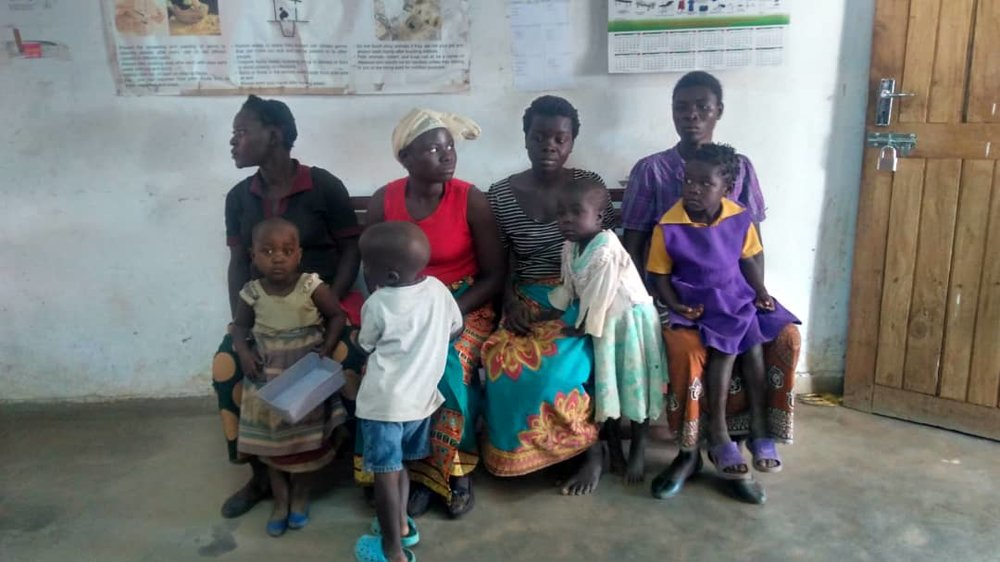 Mothers waiting with their preschool students inside the clinic for hemoglobin testing, part of our on-going healthcare programs through our schools.