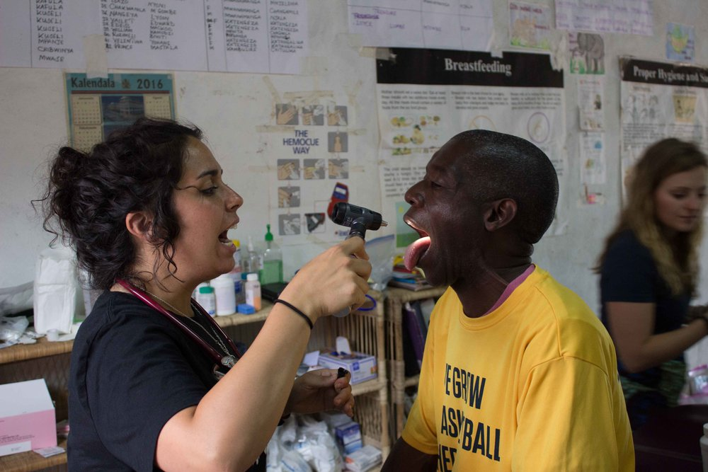 Even grown ups need a doctor or a nurse! Sylvana gives Pastor Lungah a check-up!