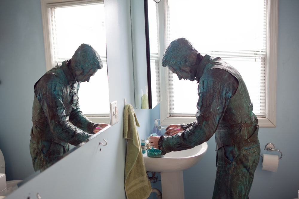 Patrick Toney works in Seattle, Washington as a street artist and living statue.  Here, he prepares for a day of work in his home.