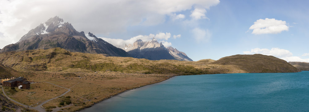 Pehoé Lake sits below the Paine Grande Peak with Cuernos del Paine in the background.