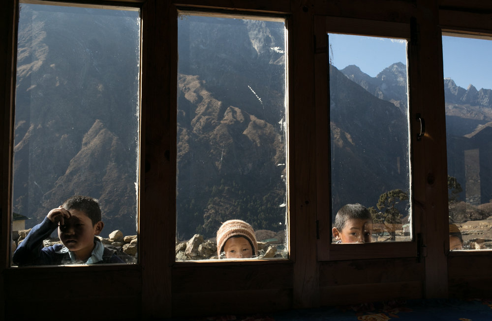 Children peer into the window as we eat lunch in Phortse, Nepal.