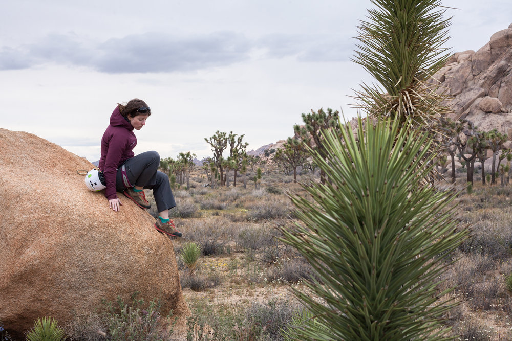 Rachel Morgan scrambles down a boulder in Joshua Tree National Park, California.