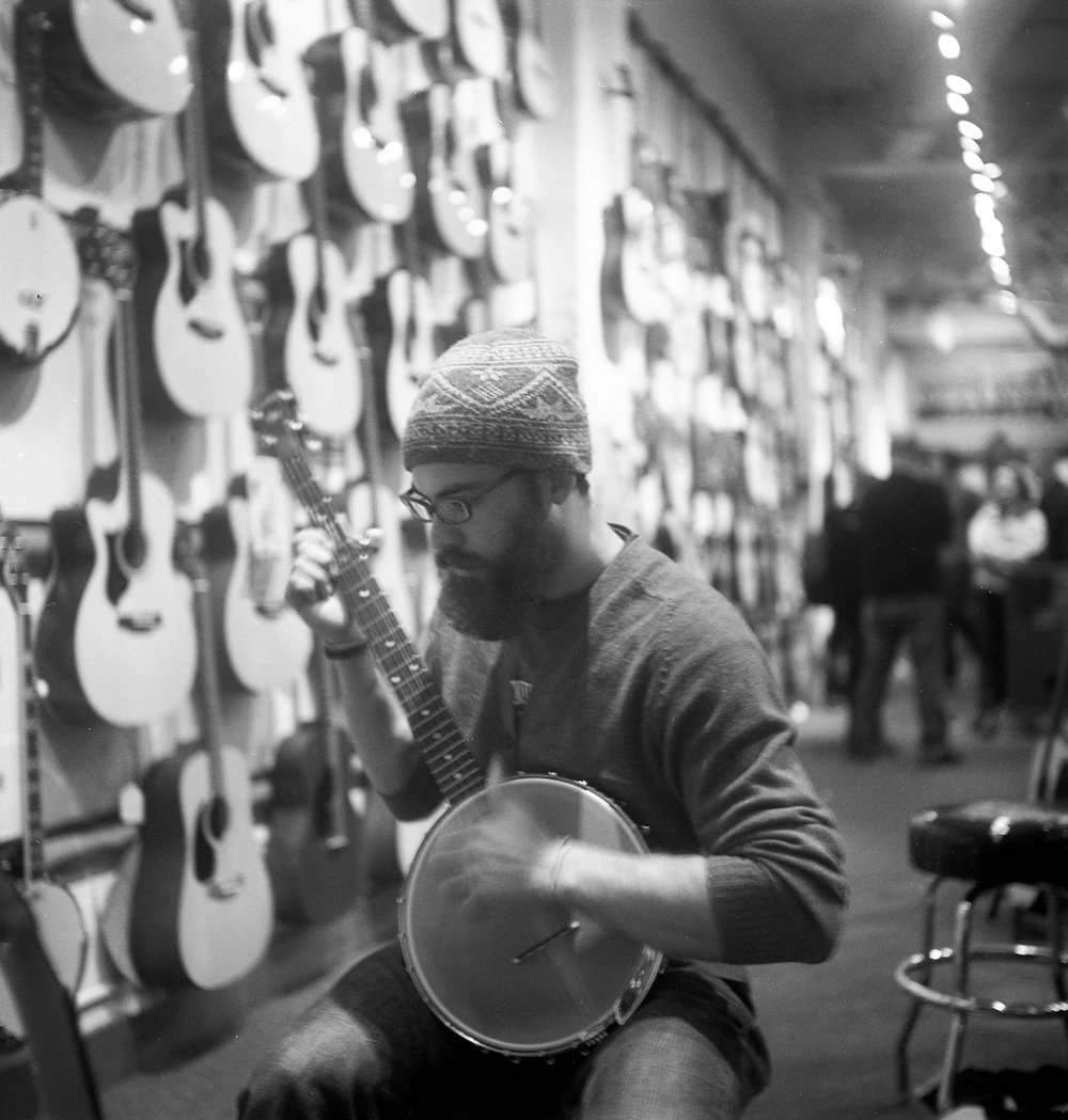 Aaron Hefty (now Hefstad), playing banjo at Dusty Strings, 2011.