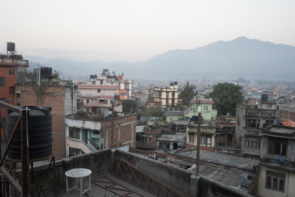 Waking up in Kathmandu. A sunrise view from the Manang Hotel. The city is alive with sounds; pigeons cooing, a rooster crowing, and car horns chirping at each other.