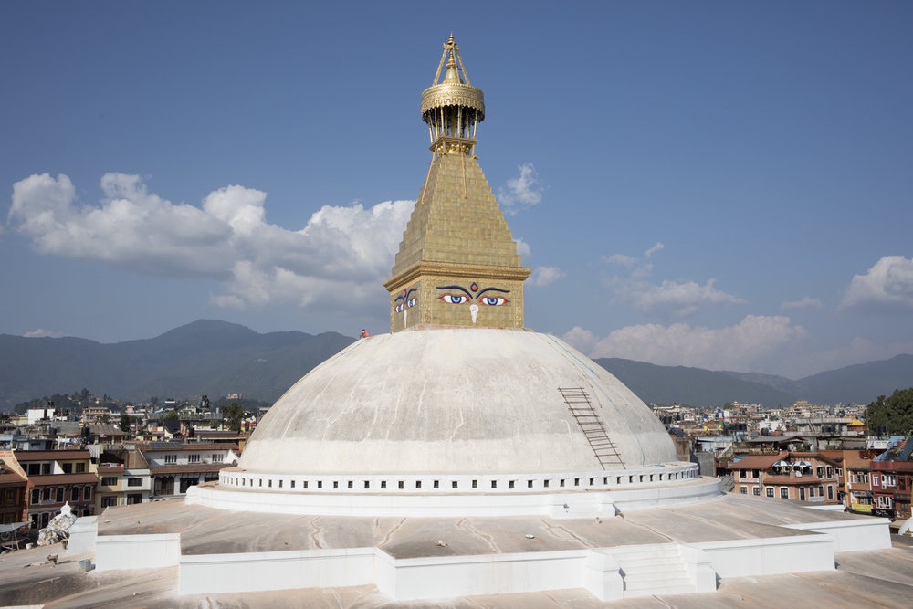 The base of the Boudhanath Stupa is shaped to represent a mandala.  The community around the temple is largely buddhist, including a large population of Tibetan refugees.