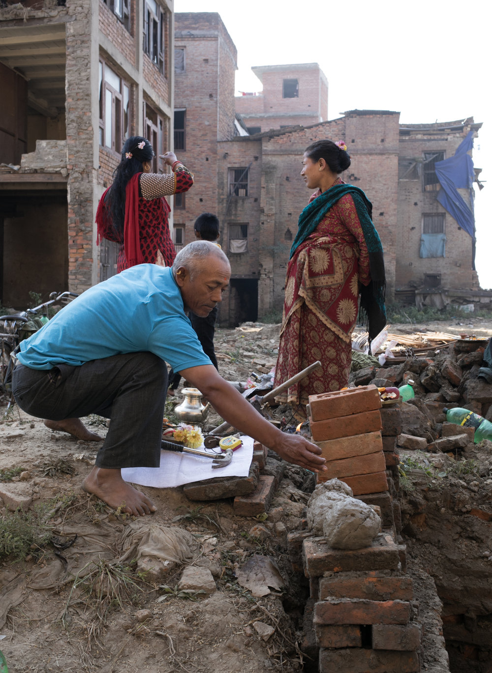 Much of the earthquake relief money raised is still held by the Nepal government.  Some of the funds have been allocated to fix temples, but many families are left to repair their homes independently.