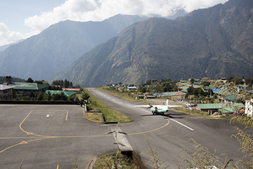 Lukla airport is said to be one of the most dangerous airports.  The runway is short, and the weather temperamental.  When we landed we felt the urgent catch of the brakes as we quickly came to a stop.