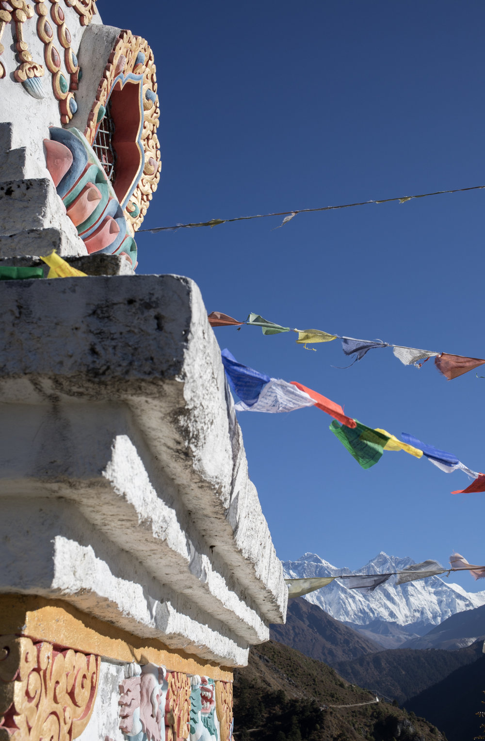 A view of the mountains around a carves stupa.