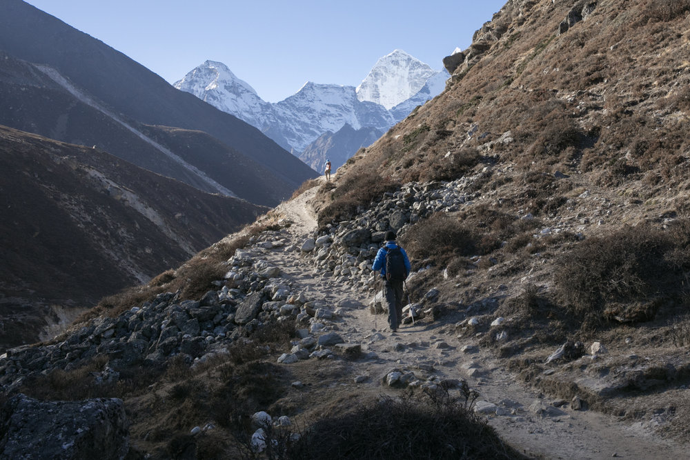 On our return journey, we hiked along the less traveled side of the Imja Khola river from Pheriche to Phortse.  The trail is more narrow and provide some exposed views of the steep valley below. .