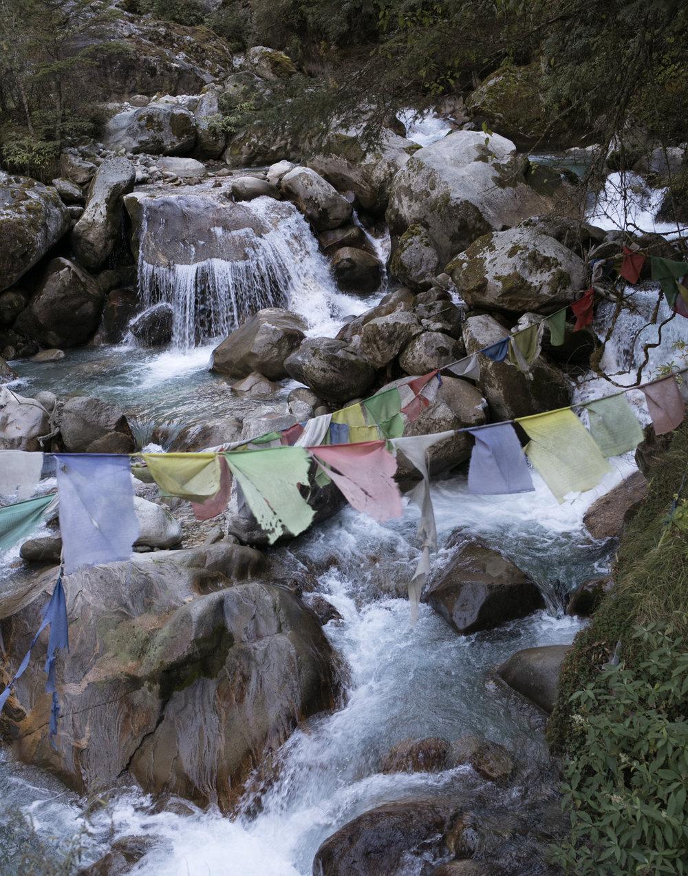 Prayer flags near the Koshi Nadi river.