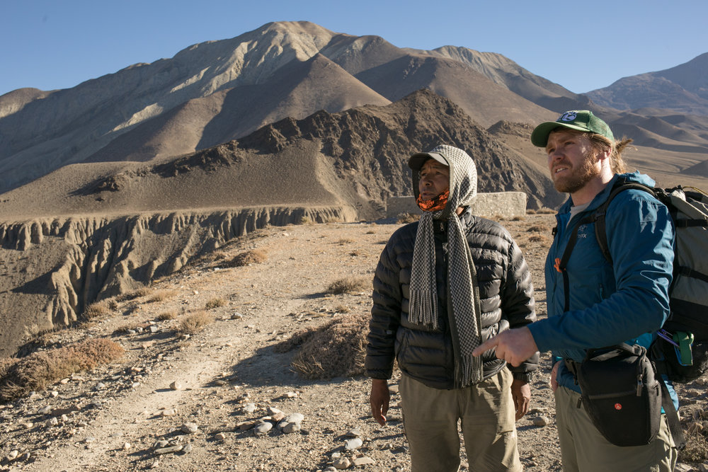 Our guide Lakpa Sherpa and Aaron discuss the geography of the region.  The valley walls rise quickly and are a mixture of brown, red, orange, and yellow - a desert palate.