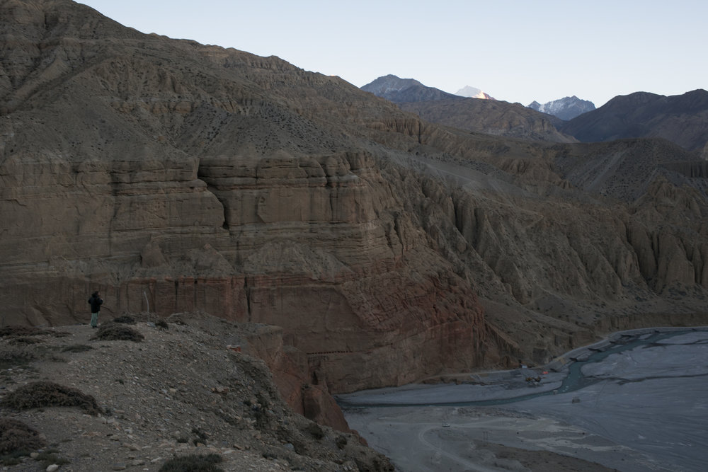 Aaron peers over the Kali Gandaki Nadi river.  Now that we had made it to Chele we would move away from the river and into the mountains.
