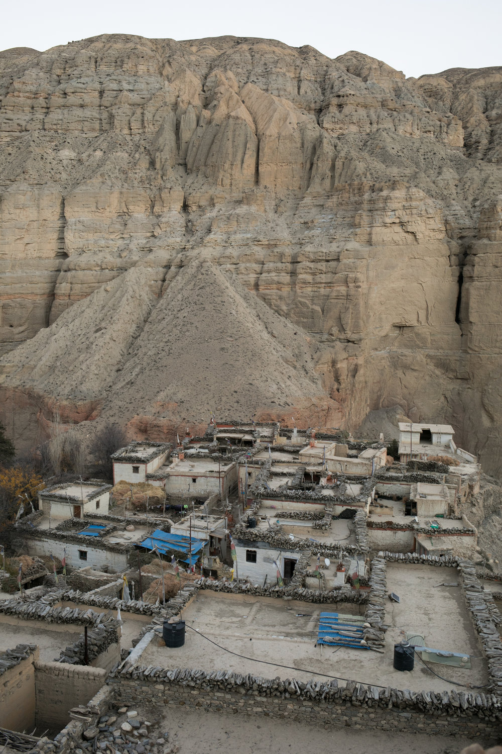Chele is a small village and is one of the first places to stay in the Upper Mustang. Firewood and kindling is cut and staked around the roof edge to dry.  This region has very little access to resources so the community prepares for the winter season early.