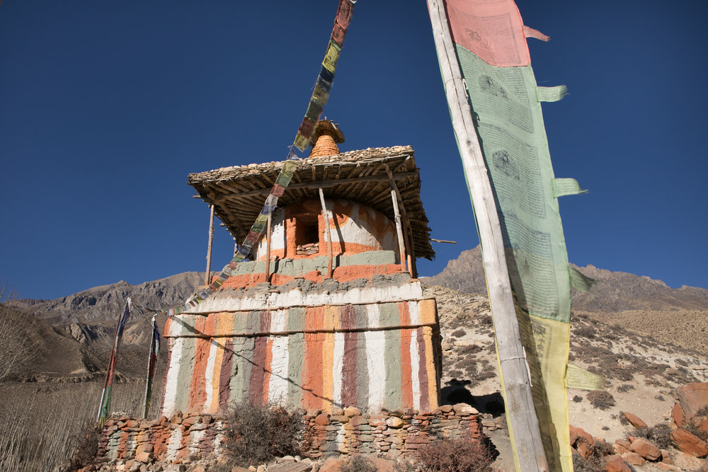 An impressive large painted chorten and prayer flags.