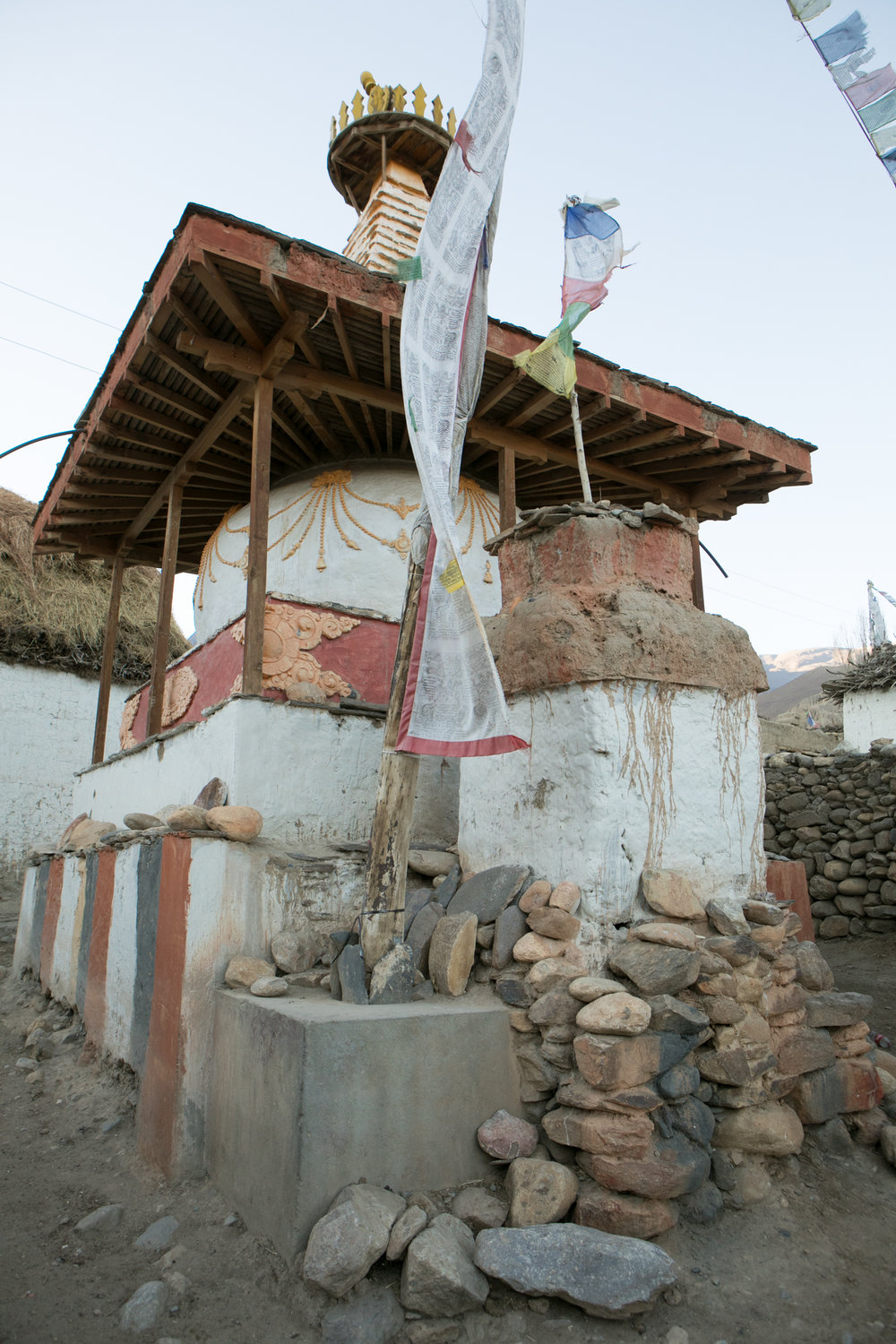 Chorten and mani stones. As we walked through town a tea house owner invited us to see his prayer room and to join him for tea. I don't have any photos but the space was beautiful.  As we drank tea his cat trotted into the house and brought us a gift of a dead mouse. We stayed and talked of the road and the controversy around it.  Many people don't want the road because they fear it will change this remote region while others want the road to bring in goods and provide access to supplies. He said that he feels his community would remain the same and not lose their traditions with the new trade route.  He welcomed the access to resources.