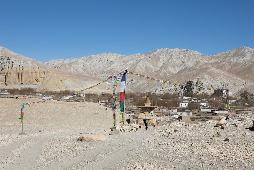 A large chorten stands at the gate of Charang.