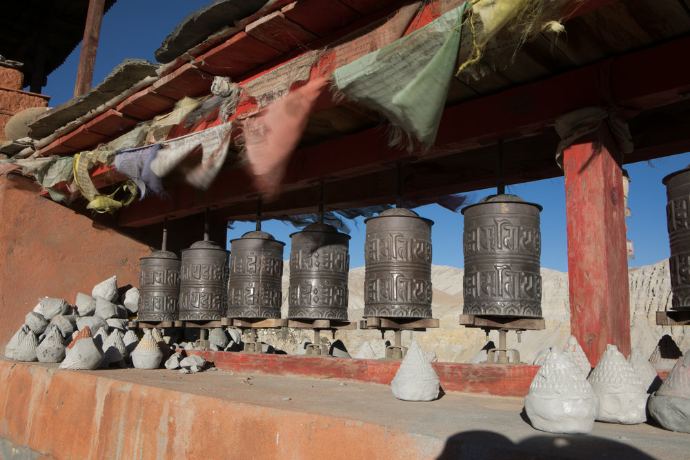Prayer wheels and small statues made of ashes.