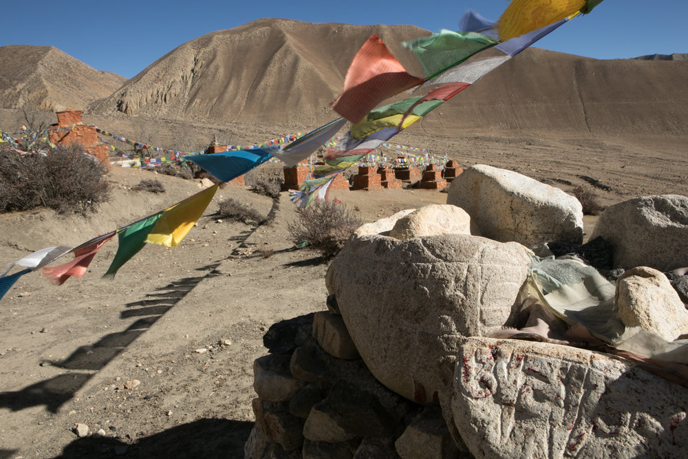 On your way to Gar Ghompa you pass through 108 red chortens, many with prayer flags and Mani stones.  Rows and rows line the valley entrance.