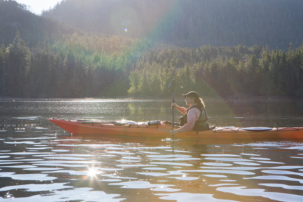 Kim enjoys a calm and peaceful morning paddle.