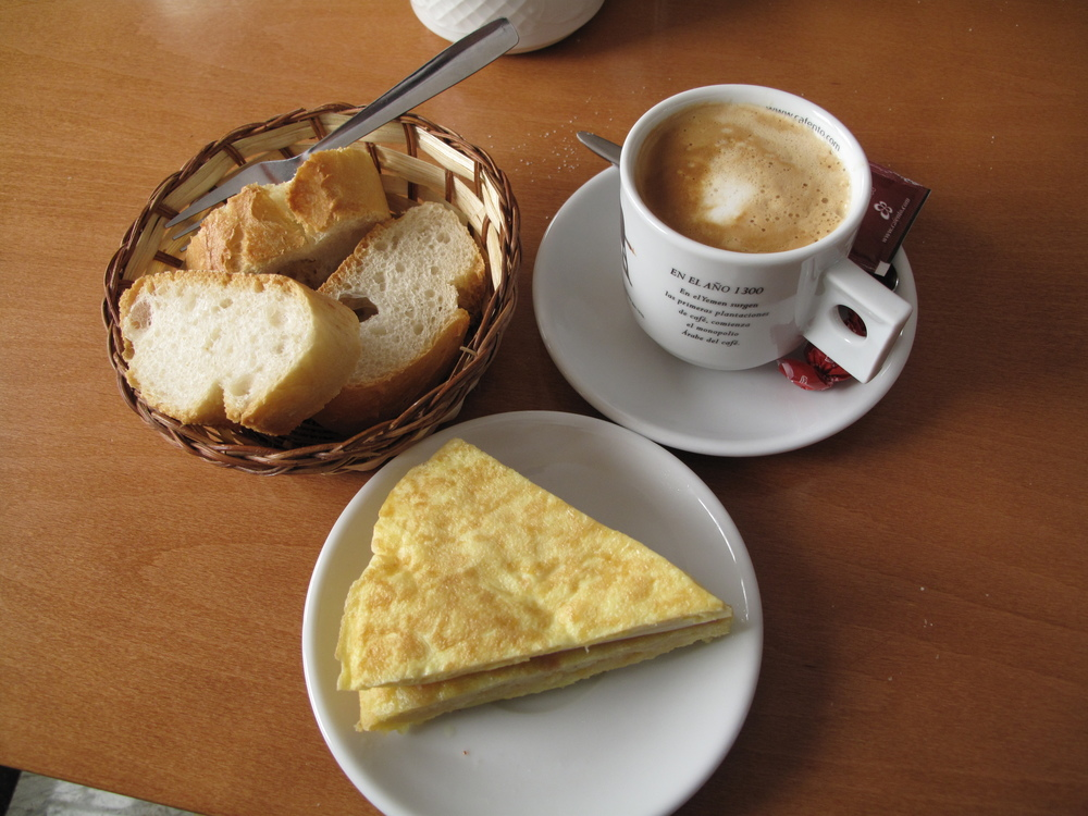 The town was closed for the most part due to it being a Sunday.  However, there was a local bar open and they were serving the standard pilgrim snack: cafe con leche y tortilla.