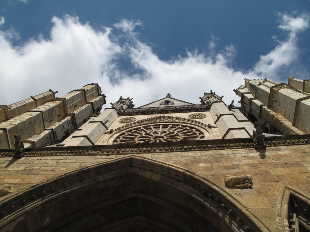 The Cathedral in León is one of my favorites on the Camino. I took the train from Sahagún to León to rest my feet. The tendonitis in my foot had gotten worse and I need to rest it as much as possible. While it was a rainy day, there was a break in the clouds. Tall churches with spires make me swoon.