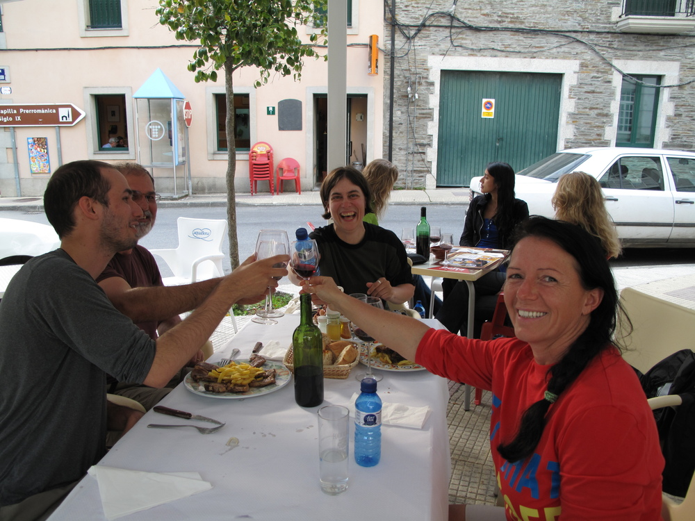 Breaking bread...or in this case, sharing vinto tinto and some pulpo with pilgrims from Germany and Brazil.