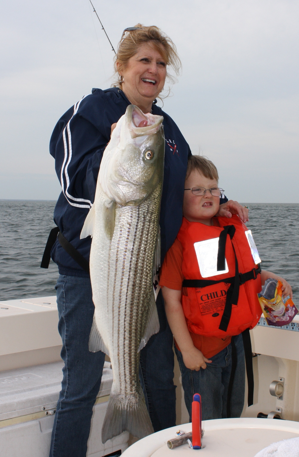 Cathy Taylor with grandson Luke Taylor - 1st Striped Bass (35 inches)