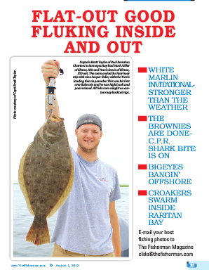 Charter client Travis Davis (Elkton,MD) holding fluke close to 8 lbs. The Fisherman magazine