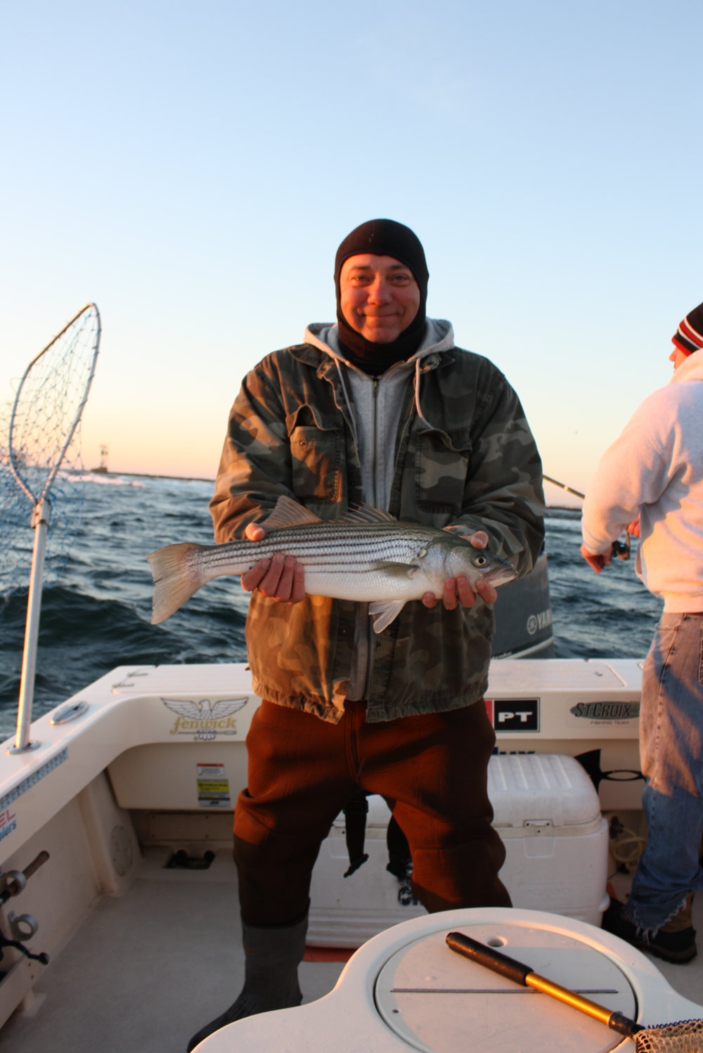 Open boat stripers on the meat reel reaction for Barnegat inlet fishing report