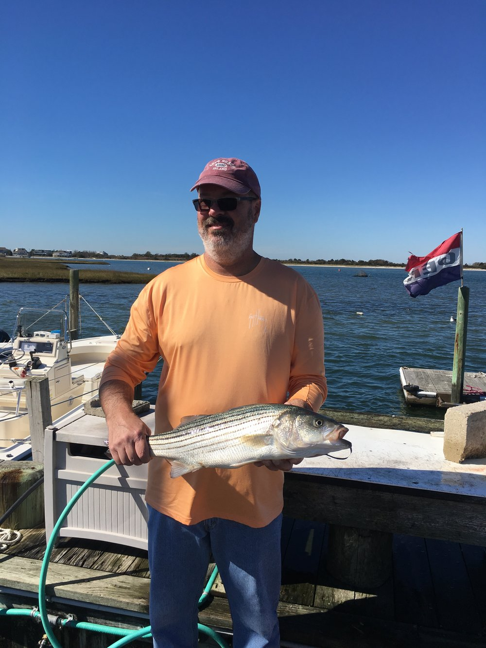 Fall striped bass charter bruce connor for Fish cleaning table bass pro