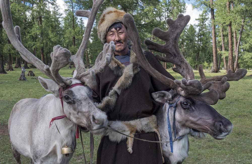 reindeer herders and his reindeer.jpg