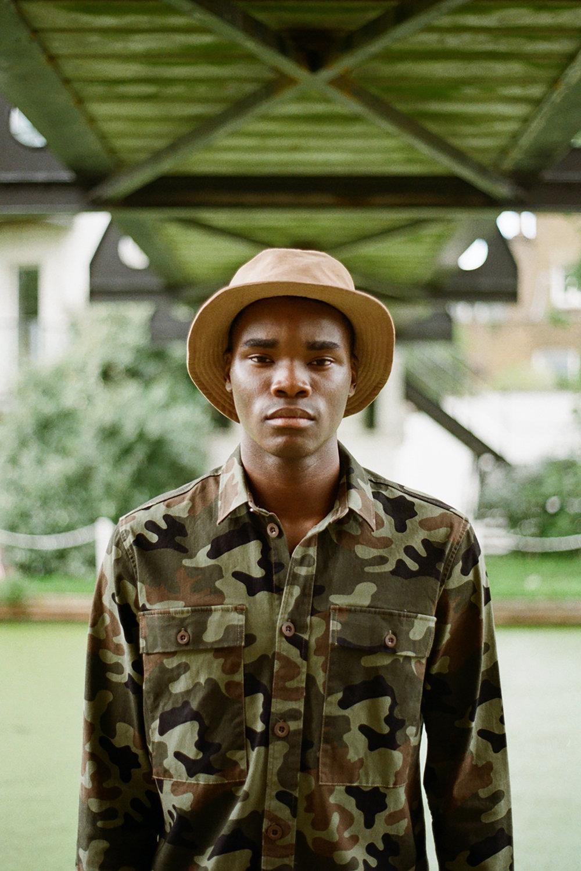 - Benji wears: Bucket hat - Nanamica, Camo Shirt - Samsøe & Samsøe