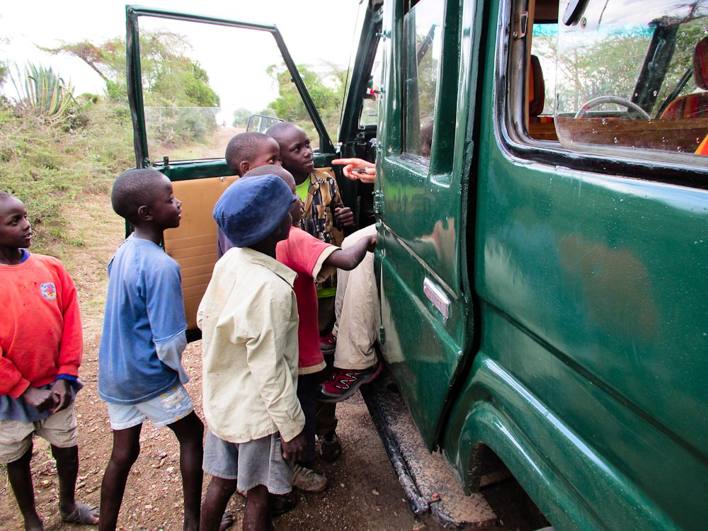 Kenyan children surrounding the truck