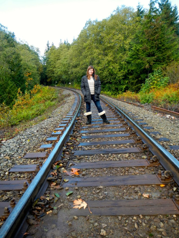 standing on the train tracks