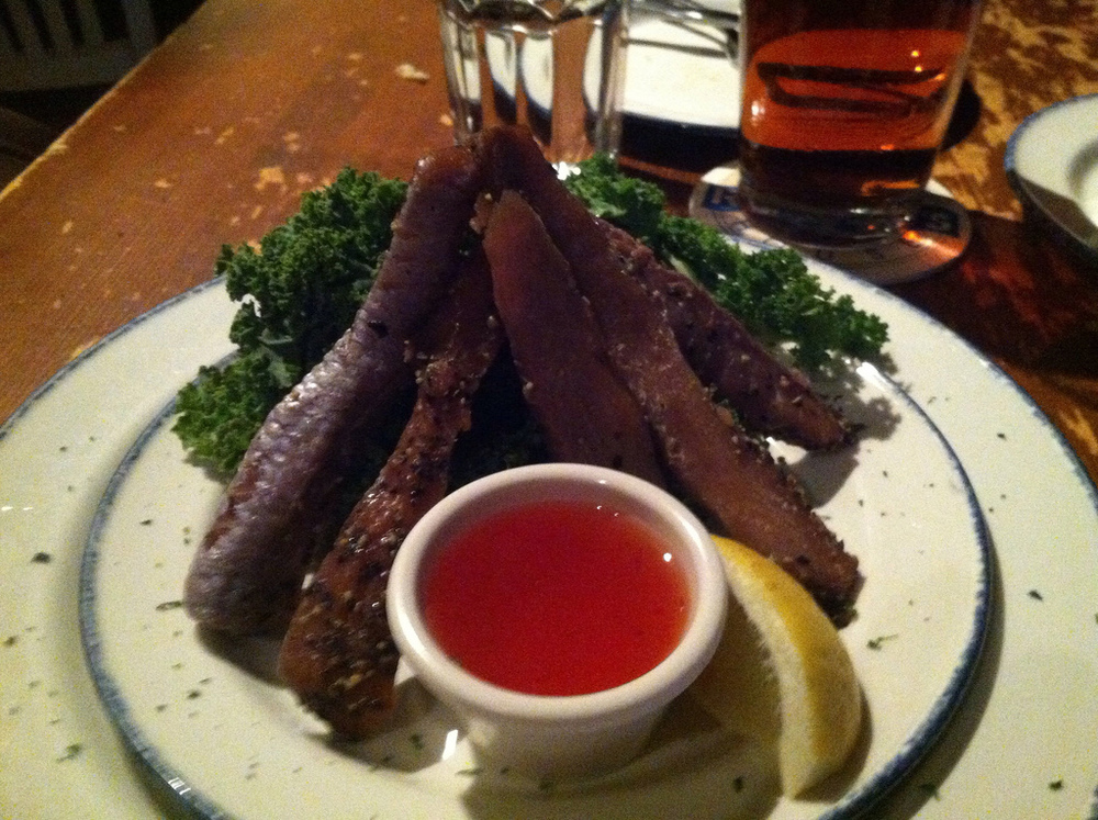 i have no idea what this is, it was something that we ordered as an appetizer and can best be described as fish jerky. it was like  chewy -smoky-fishy- candy. We tried it, but couldn't eat it.