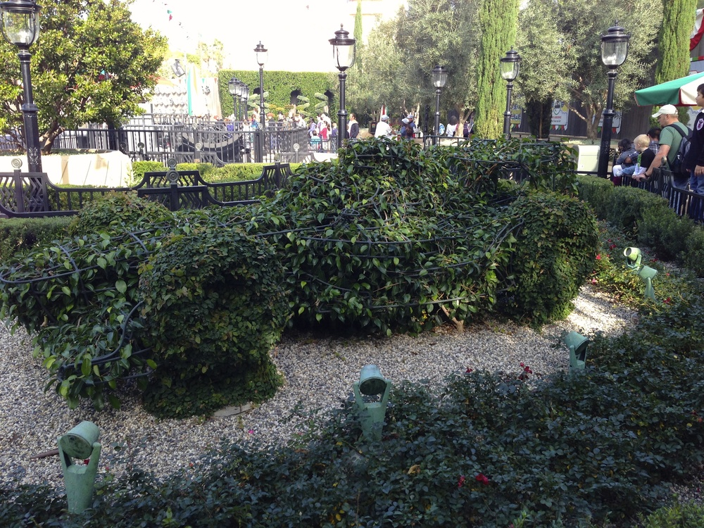 Topiary in the queue.