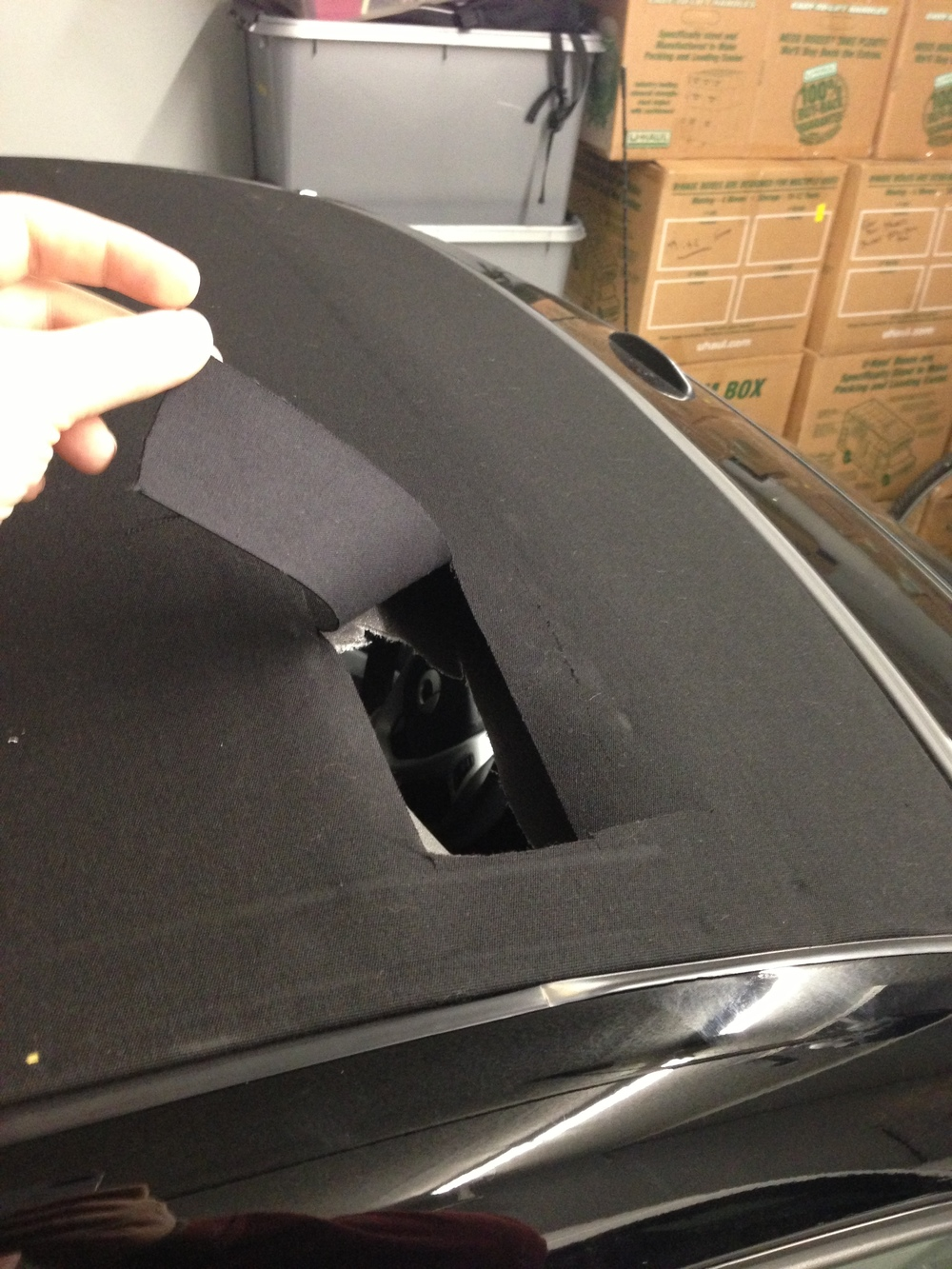 The hole thieves cut into our convertible.